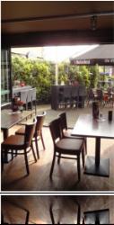 Café voorzien van geluidweerende vouwwand